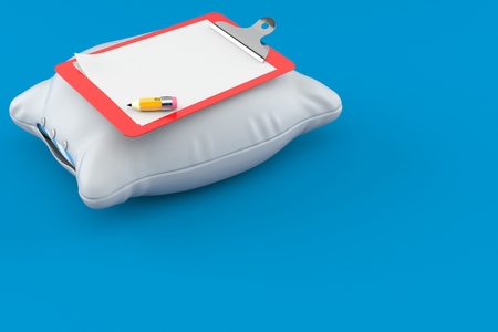 Pillow with blank clipboard isolated on blue background
