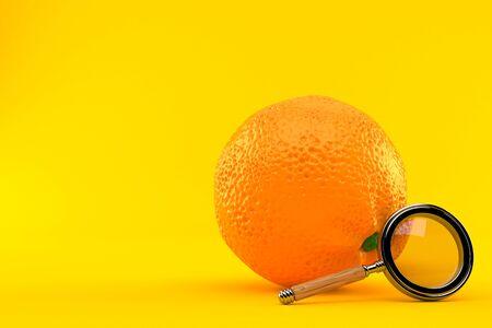 Orange with magnifying glass isolated on orange background Stock fotó