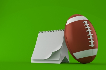 Rugby ball with blank calendar isolated on green background Stock Photo