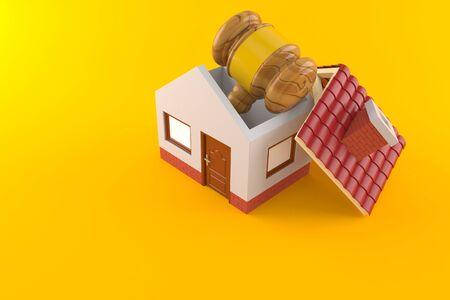 Gavel inside house isolated on orange background