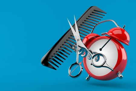 Barber scissors with comber with alarm clock isolated on blue background Stock Photo