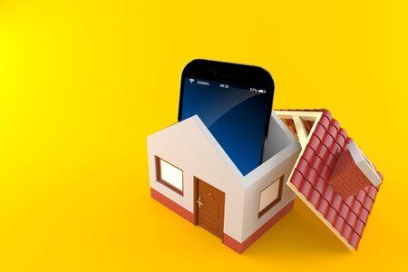 Smart phone inside house isolated on orange background Stock Photo