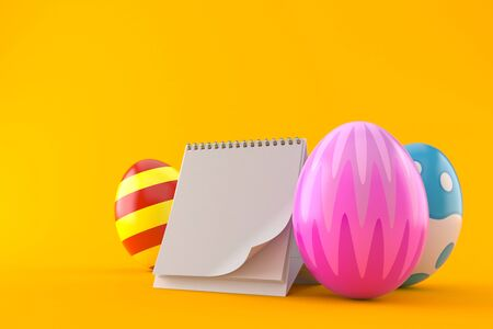 Easter eggs with blank calendar isolated on orange background