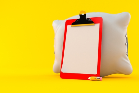 Pillow with blank clipboard isolated on orange background