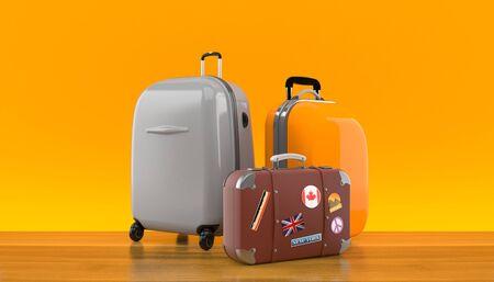 Luggage on orange background Stock Photo