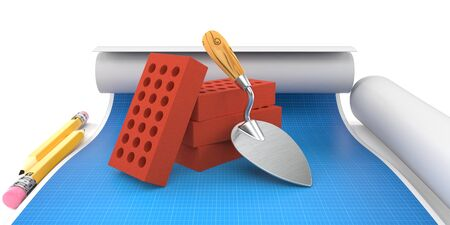 Bricks and trowel lies on blueprint Stock Photo