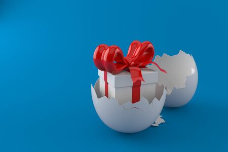 Egg shell with gift isolated on blue background Stok Fotoğraf