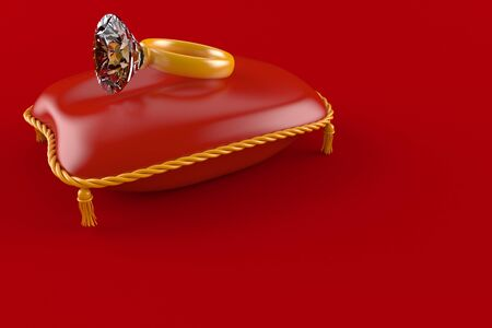 Diamond ring with red pillow isolated on red background Stock Photo