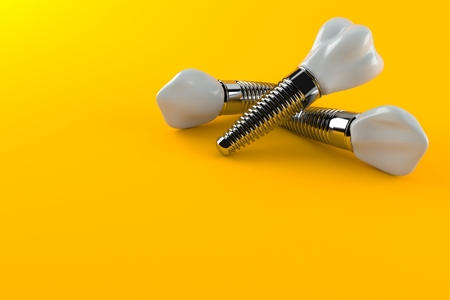 Dental implants isolated on orange background. 3d illustration Banco de Imagens