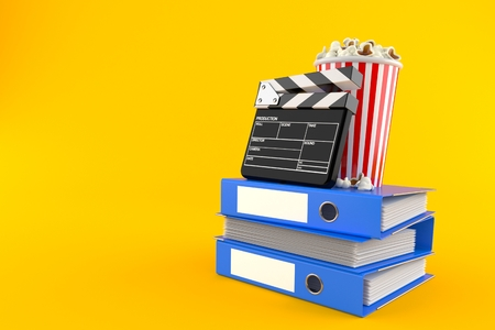 Popcorn and clapboard with ring binders isolated on orange background. 3d illustration