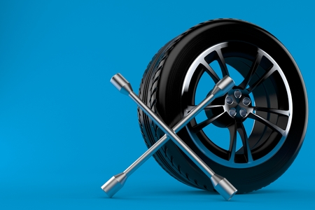Car wheel with wheel spanner isolated on blue background. 3d illustration Banco de Imagens