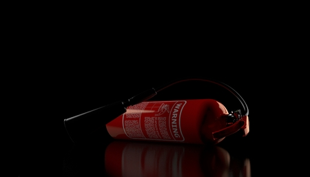 Fire extinguisher on black background. 3d illustration Reklamní fotografie