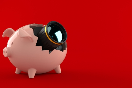 Camera inside piggy bank isolated on red background. 3d illustration