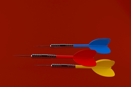 Darts isolated on red background. 3d illustration