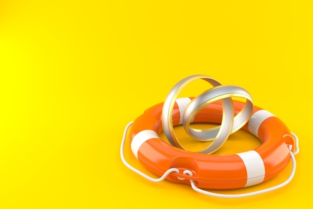 Wedding rings with life buoy isolated on orange background