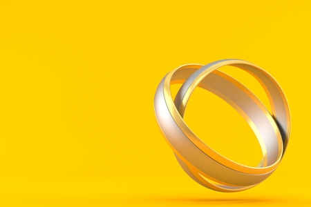 Wedding rings isolated on orange background. 3d illustration