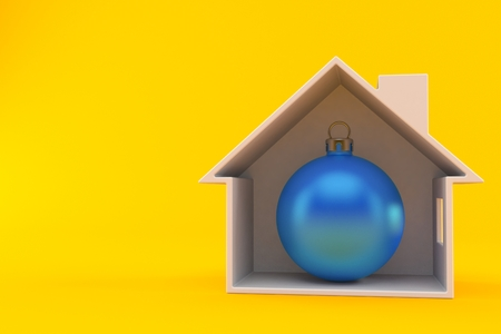 Christmas bauble inside house cross-section isolated on orange background. 3d illustration