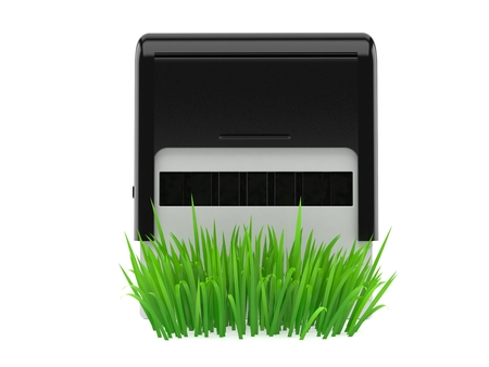 Rubber stamp on grass isolated on white background. 3d illustration Banco de Imagens