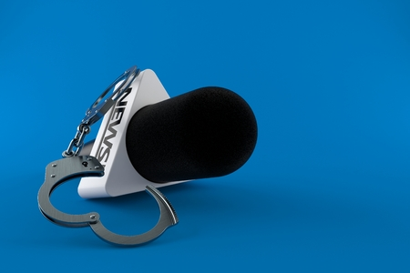 Interview microphone with handcuffs isolated on blue background. 3d illustration Stock Photo