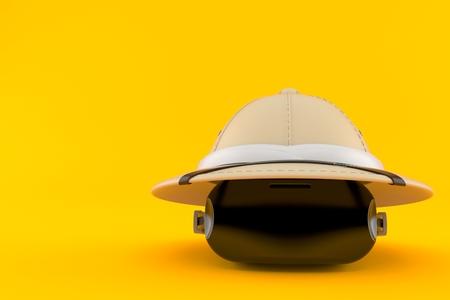 VR headset with safari hat isolated on orange background. 3d illustration Reklamní fotografie