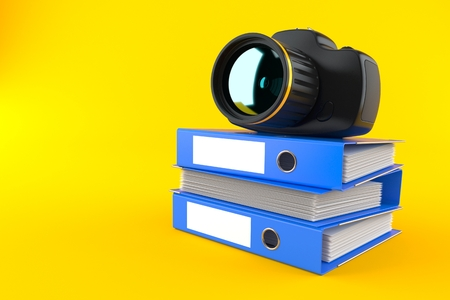 Camera on stack of ring binders isolated on orange background. 3d illustration Archivio Fotografico - 116379316