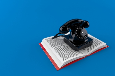 Telephone on open book isolated on blue background. 3d illustration