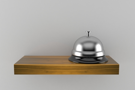 Hotel bell on wooden shelf isolated on gray background. 3d illustration Фото со стока