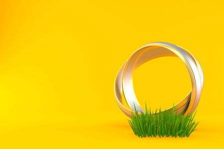Wedding ring on grass isolated on orange background. 3d illustration