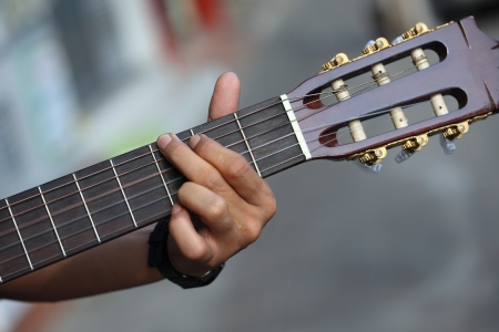chord: guitar chord played outdoors  Stock Photo