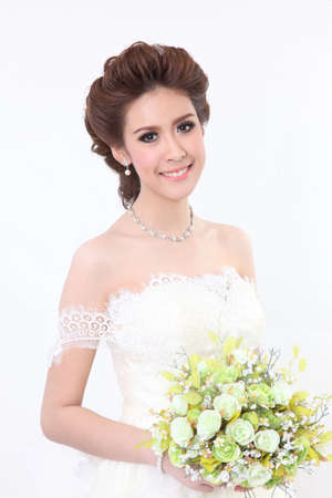 Young attractive bride with the bouquet of white roses  photo