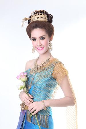 chignon: elegant fashion asian woman posing with creative chignon hair-style and wearing blue thai dress