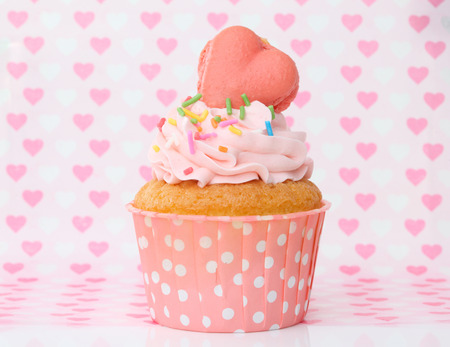 cupcakes with vanilla frosting and cute hearts for Valentines Day, Mothers Day, birthday Christmas or special romantic occasion  photo