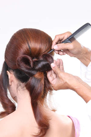 The hairdresser make the hair chignon photo