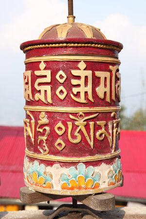 Tibetan prayer wheels in Buddhism temple photo