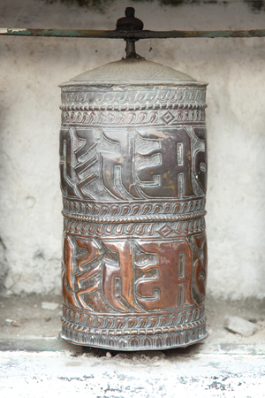 Tibetan prayer wheels in Buddhism temple photo