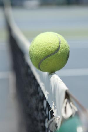 Tennis ball hitting the net photo