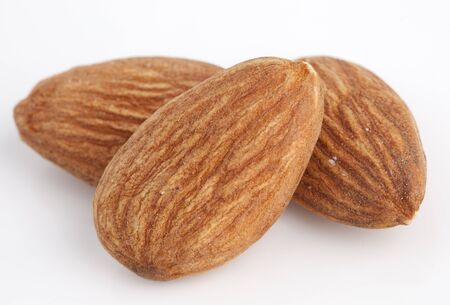 nutshells: almonds isolated on the white background Stock Photo
