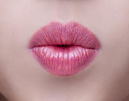 lipgloss: Sexy Lips. Beauty Red Lip Makeup Detail. Beautiful Make-up Closeup. Sensual Open Mouth. lipstick or Lipgloss. Kiss. Beauty Model Womans Face close-up