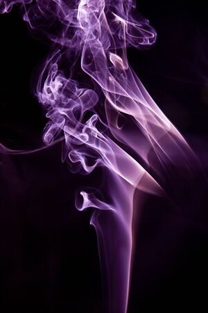fumes: Colorful smoke abstract curly on black background Stock Photo