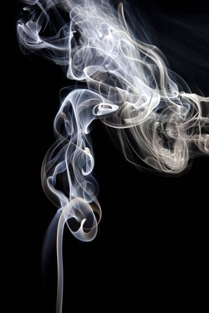 photographic effects: Colorful smoke abstract curly on black background Stock Photo