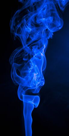 incense: Colorful smoke abstract curly on black background Stock Photo