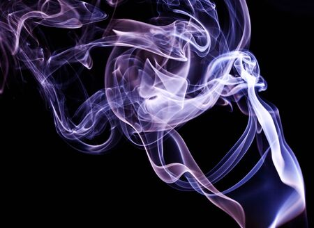 light painting: Colorful smoke abstract curly on black background Stock Photo
