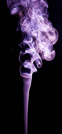 fume: Colorful smoke abstract curly on black background Stock Photo