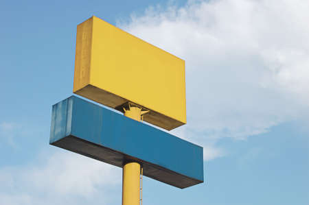 A tall yellow and blue blank signboard Stock Photo - 642544