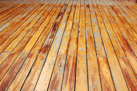 Weathered floorboards on a balcony in Thailand photo