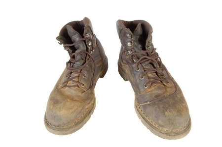walking boots: A pair of dirty old walking boots with clipping path