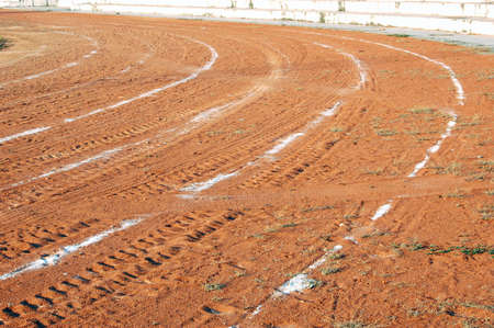 scuff: Abstract of a local athletics running track of sand Stock Photo