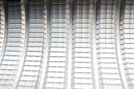 tred: Background of curved metal roof in a bus shelter Stock Photo