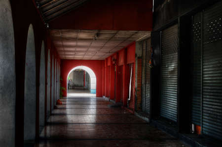 disused: Disused retail outlets along a dark corridor