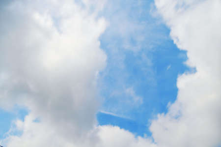 cloud drift: Fair weather clouds with blue sky behind
